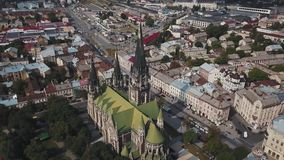 Fly around an old Gothic cathedral in old European city.  stock footage