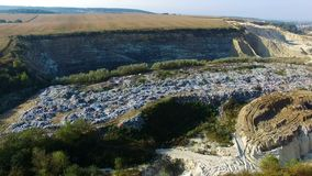 Fly around rubbish dump near weat agricultural fields. Aerial view. Autumn morning stock footage