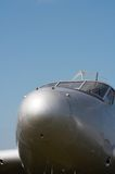 Fly away. The shiny metal nose of an airplane royalty free stock photography