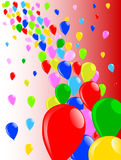 Fly Away Balloons. Multi coloured balloons flying away into the sky Royalty Free Stock Photos