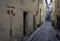 Fly Away Florentine street graffiti. Graffiti in a typical Florentine street. in the old historical town streets are narrow and are the best way to move is the Stock Images