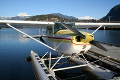 Fly Away With Me. A floatplane tied to a dock in Squamish, British Columbia stock photos