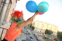 Fly with balloons adventure. Young woman adventurer is going to fly with balloons over the city Royalty Free Stock Images