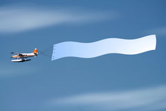 Fly with banner Stock Image