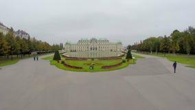 Fly through Belvedere Palace gates in Austria Vienna aerial shot
