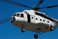 Fly big white helicopter Stock Images