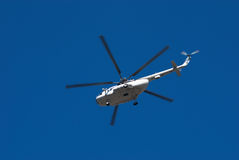 Fly big white helicopter Stock Image
