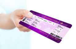 Fly boarding pass ticket holded by hand over white background. Violet fly boarding pass ticket holded by hand over white background Royalty Free Stock Photos