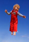 Fly boy. Father throwing up his son. Blue sky on the background stock images