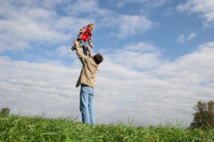 Fly child on father's hands Royalty Free Stock Image