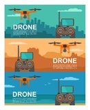 Fly drone with remote control on background city, sea, mountain. Stock Photos
