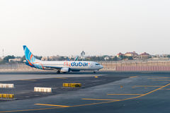 Fly Dubai passenger jet taxiing to the terminal after landing at Royalty Free Stock Images