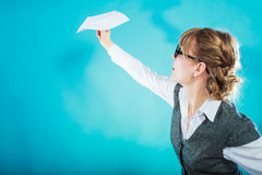Fly fear. Woman holding airplane in hand. Royalty Free Stock Images