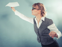 Fly fear. Woman holding airplane in hand. Royalty Free Stock Photo