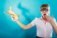 Fly fear. Woman holding airplane in hand. Stock Image