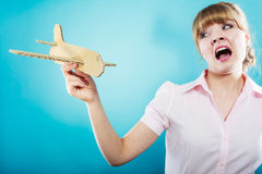 Fly fear. Woman holding airplane in hand. Stock Photo