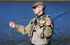 Fly-fisher. In action on the Swedish westcoast stock photo