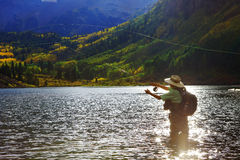 Fly Fisher. In the lake at Maroon Bells near Aspen, Colorado royalty free stock photos