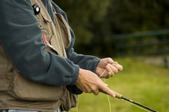 Fly fisher. Focus on body and rod stock image
