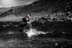 Fly Fisher - Speycasting in windy conditions Stock Photo