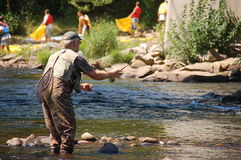 Fly Fisherman. Man fly fishing in a river Royalty Free Stock Photos