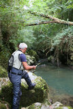 Fly-fisherman fishing in river having fun Stock Images