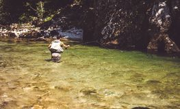 Fly fisherman. Flyfishing in river Royalty Free Stock Photography
