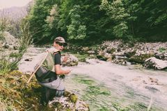 Fly fisherman. Flyfishing in river Stock Images