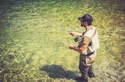 Fly fisherman. Flyfishing in river Stock Photo