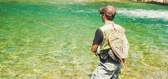 Fly fisherman flyfishing in river Stock Photo