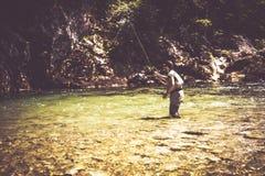 Fly fisherman. Flyfishing in river Royalty Free Stock Image