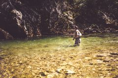 Fly fisherman. Flyfishing in river Royalty Free Stock Images
