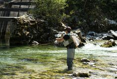 Fly fisherman. Flyfishing in river Royalty Free Stock Photo