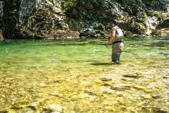 Fly fisherman flyfishing in river Stock Photography
