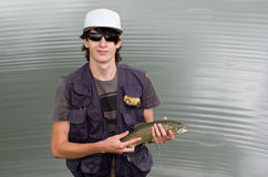 Fly fisherman with rainbow trout royalty free stock images