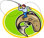 Fly Fisherman Riding Trout Fish Cartoon. Illustration of a fly fisherman holding rod and reel riding trout fish set inside oval shape done in cartoon style on Stock Images