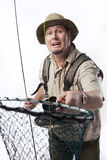 Fly fishing. Fly fisherman holding out net to camera Royalty Free Stock Photo