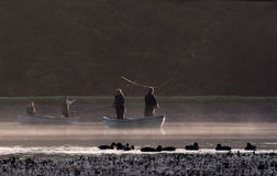 Fly fishing. Early morning on a misty lake Royalty Free Stock Photography