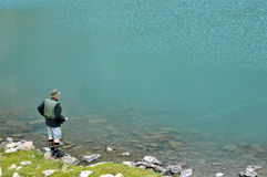 Fly Fishing. Fly fisherman on a lake (Alp Stock Photos