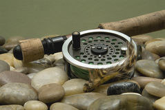 Fly Fishing. Flyfishing rod and reel with a brown popping bug stock image