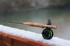 Fly fishing. Rod on snow covered bridge Royalty Free Stock Images