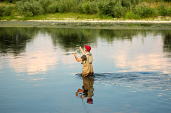Fly fishing. Fisherman angling on the river Royalty Free Stock Image