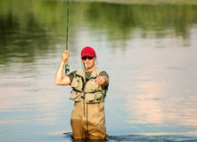 Fly fishing. A fisherman just caught a fish Stock Photo
