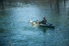 Fly Fishing. Man fly fishing the stream from his kayak Royalty Free Stock Photo