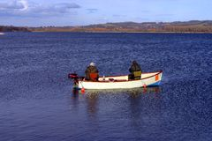 Fly fishing. Two men fly fishing on a lake in Somerset, England stock images