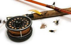 Fly Fishing. Rod and reel with selection of fishing flies Royalty Free Stock Image