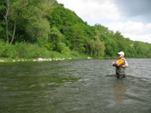 Fly fishing. On river in summer Stock Photo