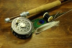 Fly fishing. Rod with fly tying items Stock Image