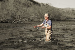 Fly fishing. On black and white background Stock Photos