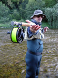 Fly fishing. On river in wildness Royalty Free Stock Images